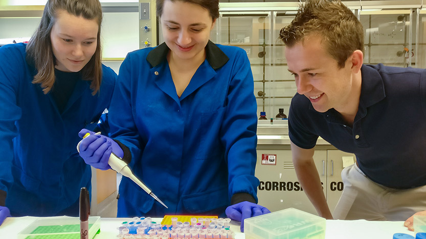 Bryan Dickinson (right) discussing research with graduate students Kaitlin Kentala (left) and Simone Rauch (middle).