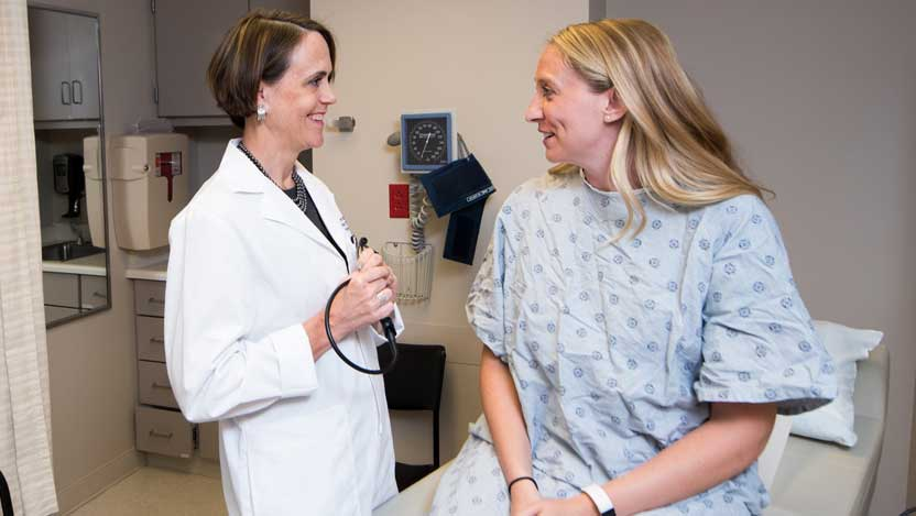 Jessica Donington, MD, and patient in DCAM clinic