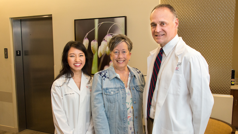 Patient Elaine Johnson (center) with Grace Suh and Michael Bishop