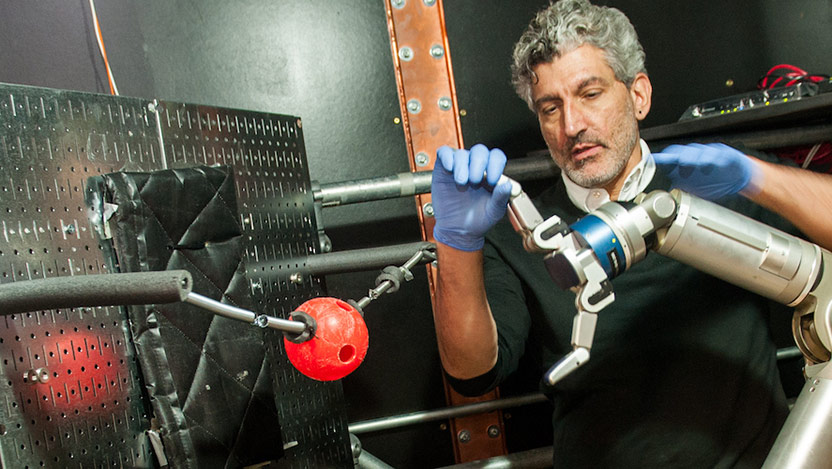 Scientist pictured with robot arm