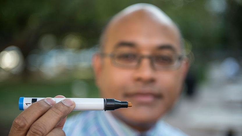 Jayant Pinto, MD, professor of surgery, with one of the Sniffin