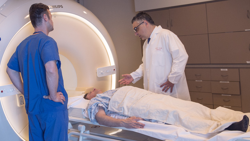 Aytekin Oto with a patient in the MRI machine