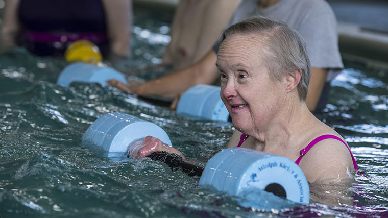 Image of a Misericordia resident swimming and doing water aerobics