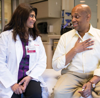 Medical oncologist Sonali Smith, MD, and lymphoma patient Clayton Harris