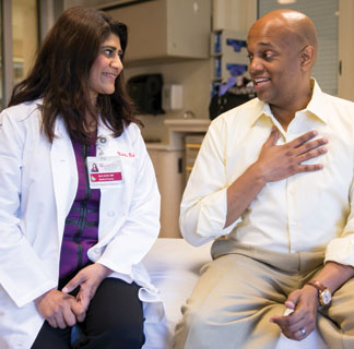 Sonali Smith, MD, talks with Clayton Harris, a lymphoma patient
