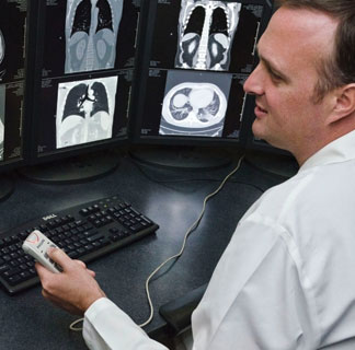 Radiologist Christopher Straus, MD, reviews radiology images