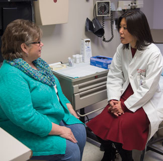 Gynecologic oncologist S. Diane Yamada, MD, meets with a patient