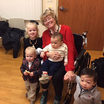Diane with her grandkids in the CCD on Christmas eve