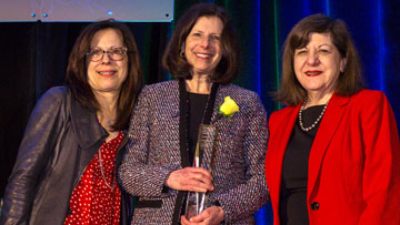 Susan Cohn, MD, center, accepting Joseph H. Burchenal award at 2019 AACR