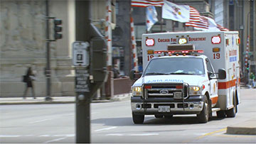 Ambulance drives through downtown