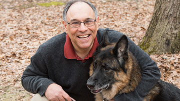 Greg Karczmar, PhD, colorectal cancer survivor, and his dog, Maddie
