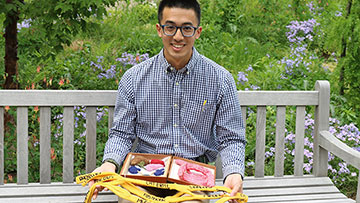 Pritzker student Daniel Lam with a knitting project
