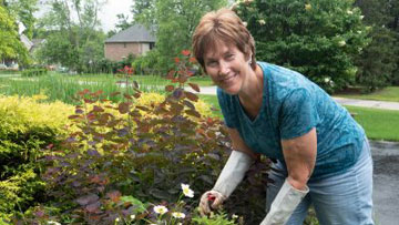 Ellen Szelina working in her garden