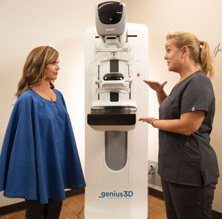 mammogram machine with patient and tech