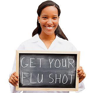 "Woman holding ""Get your flu shot"" chalkboard sign"