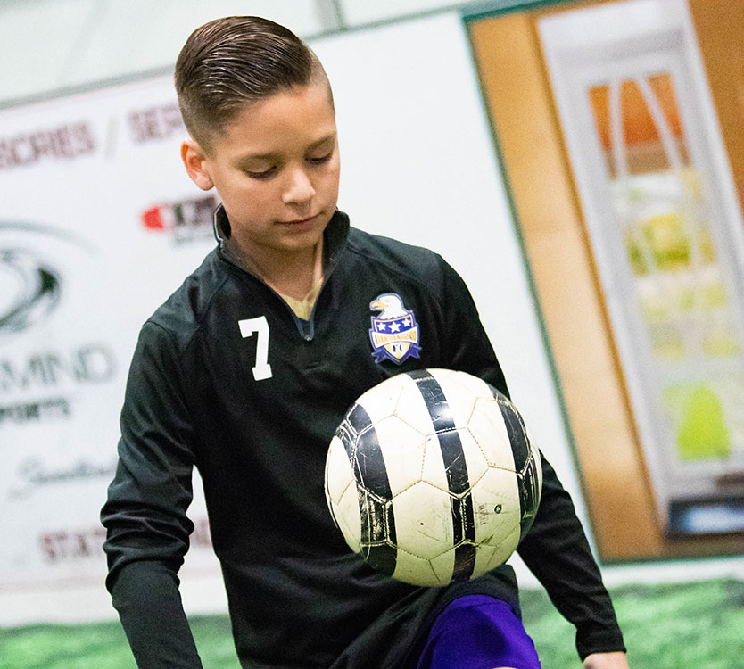 Islet transplant patient, Luke Clouser, warming up at soccer practice