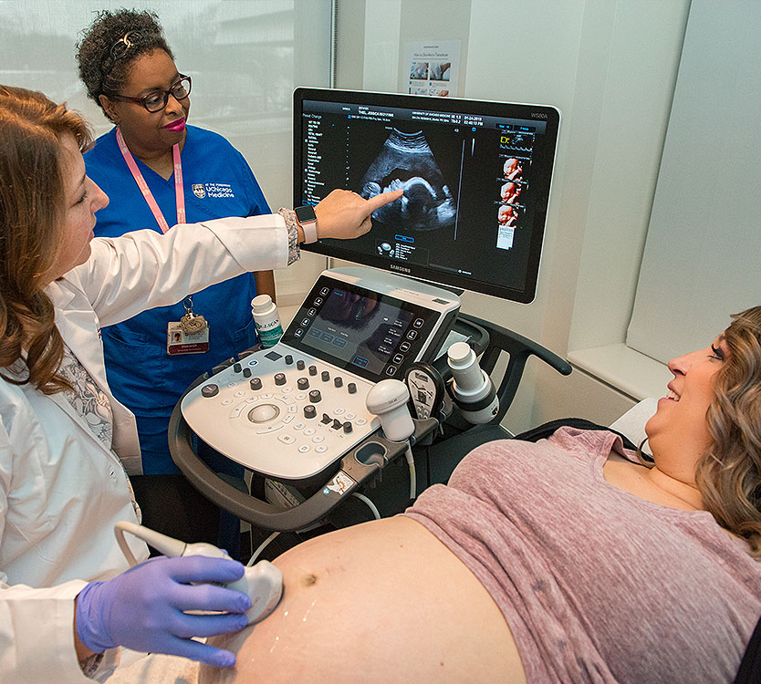 Maternal-fetal medicine physician Julia Bregand-White reviews an ultrasound image with a patient