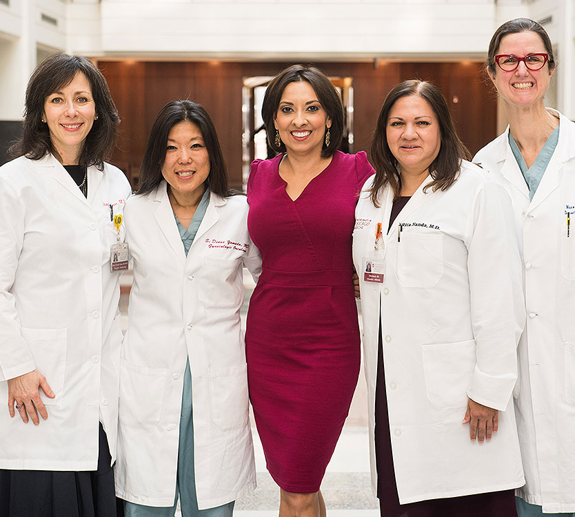 Breast cancer survivor Michelle Kerulis with her physician team