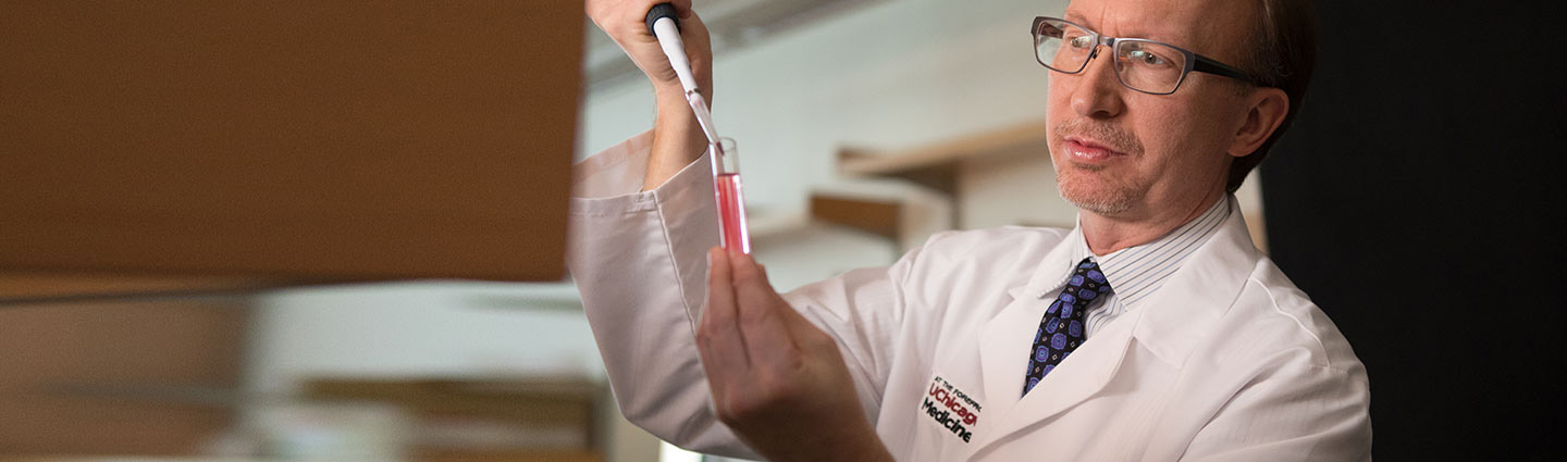 Thomas Gajewski, MD, in lab with pipette