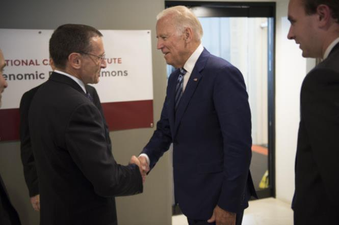 Vice President Joe Biden greets Kenneth Polonsky, MD, executive vice president for Medical Affairs, as he arrives to launch the NCI Genomic Data Commons (GDC), a system designed and developed by the Center for Data Intensive Science at the University of Chicago and presented Monday, June 6, 2016, at their office in the Shoreland in Chicago.  (Photo by Robert Kozloff)