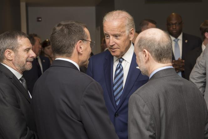 Vice President Joe Biden greets Kenneth Polonsky, MD, executive vice president for Medical Affairs, and Prof. Robert Grossman, MD, right, Department of Medicine and the College and Senior Fellow with the Computation Institute, as he arrives to launch the NCI Genomic Data Commons (GDC), a system designed and developed by the Center for Data Intensive Science at the University of Chicago and presented Monday, June 6, 2016, at their office in the Shoreland in Chicago. At left is Douglas Lowy, MD, acting director of the National Cancer Institute.    (Photo by Robert Kozloff)