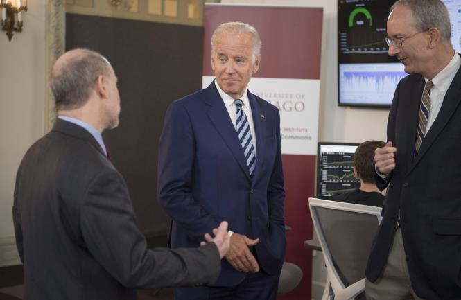 Vice President Joe Biden talks with Prof. Robert Grossman, MD, Department of Medicine and the College and Senior Fellow with the Computation Institute, and Louis M. Staudt, MD, PhD, right, with the NCI, as they tour the NCI Genomic Data Commons (GDC), a system designed and developed by the Center for Data Intensive Science at the University of Chicago and presented Monday, June 6, 2016, at their office in the Shoreland in Chicago.  (Photo by Robert Kozloff)