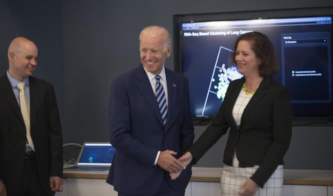 Vice President Joe Biden talks with Barbara Stranger, PhD, Piers Nash, right, both with GDC, as the vice president toured the NCI Genomic Data Commons (GDC), a system designed and developed by the Center for Data Intensive Science at the University of Chicago and presented Monday, June 6, 2016, at their office in the Shoreland in Chicago.  (Photo by Robert Kozloff)