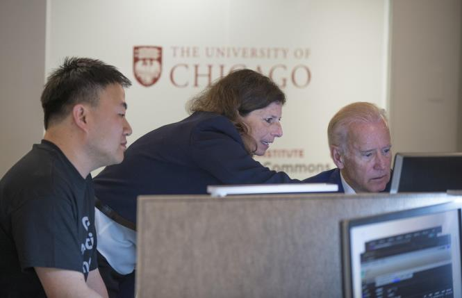 Vice President Joe Biden talks with Zhenyu Shang, PhD, and Sue Cohn, MD, as the vice president toured the NCI Genomic Data Commons (GDC), a system designed and developed by the Center for Data Intensive Science at the University of Chicago and presented Monday, June 6, 2016, at their office in the Shoreland in Chicago.  (Photo by Robert Kozloff)
