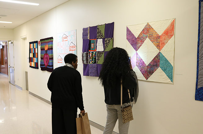 Patients view Welcome Blankets exhibit