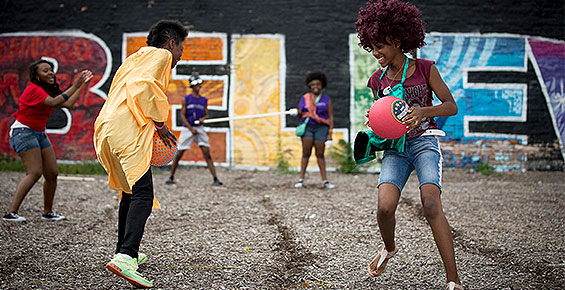 Children playing at a South Side block party event
