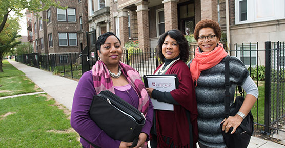 Community Health workers from left, Sigrid Tandy, Kenya Vera-Sample and Crystal Stevenson, Friday, October 28, 2016 in a Washington Park neighborhood.