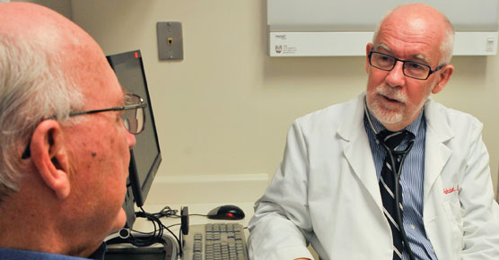 Andrzej Jakubowiak, MD, PhD, and patient in DCAM clinic