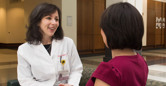 Stacy Lindau, MD, talking with a patient