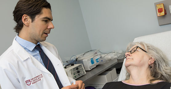Dermatologist Eduardo Moioli, MD, PhD, with patient in clinic