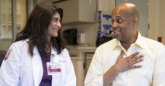 Medical oncologist Sonali Smith, MD, with lymphoma patient, Clayton Harris