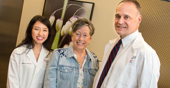 Medical oncologist Grace Suh, MD, Elaine Johnson, medical oncologist Michael Bishop, MD