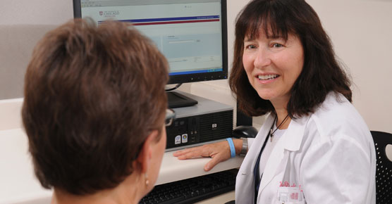 Wendy Stock, MD, talks with a patient in clinic