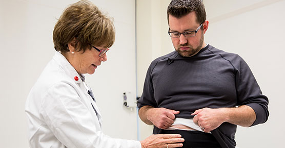 Josh Strand and Janice Colwell, RN, discuss his ostomy pouch at the Duchossois Center for Advanced Medicine