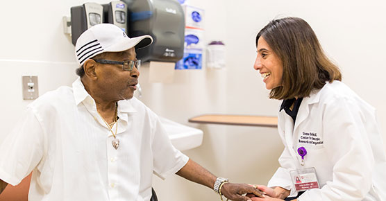 Uzma D. Siddiqui, MD, gastroenterologist, with a patient