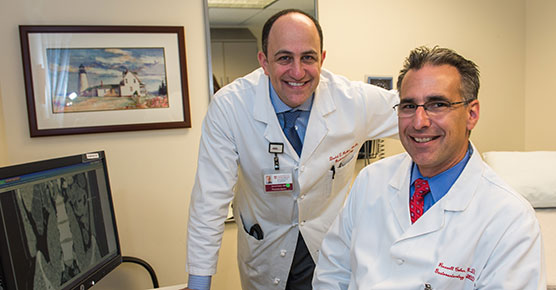 Dr. David Rubin, left, and Dr. Russell Cohen in their clinic at DCAM