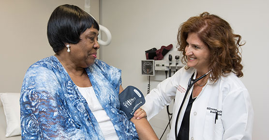Dr. Silvana Pannain, endocrinologist and leader of Chicago Weight, reading a patient's blood pressure
