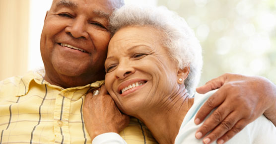 African-American elderly couple embracing