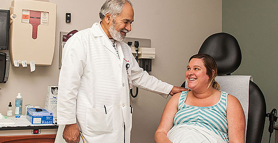 Dr. Mahmoud Ismail consults with a patient during her prenatal appointment