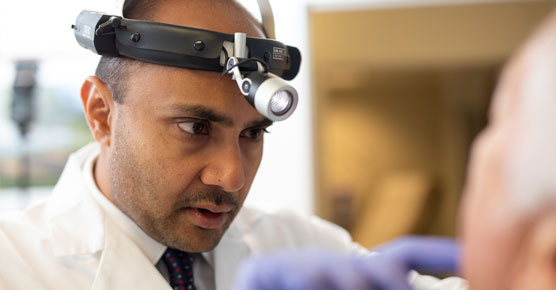 Nishant Agrawal, MD, examining patient