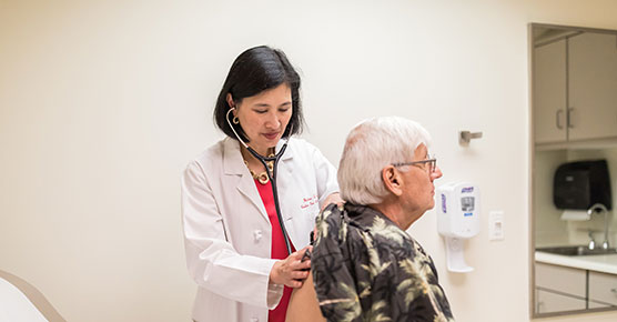 Helen Te, MD, Medical Director of the Adult Liver Transplant Program, with a patient