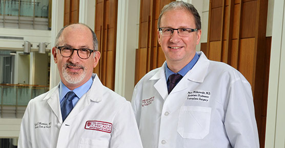 Photo of members of the Pancreas Center Team, Jeffrey Matthews, MD, Chair of the Department of Surgery, and Piotr Wikowski, MD, PhdD, Assistant Professor of Surgery and the Director of Pancreatic and Islet Transplant Program