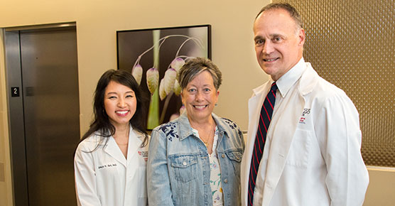 (L-R) Grace Suh, MD, medical oncologist, Elaine Johnson, patient, and Michael Bishop, MD, medical oncologist at the University of Chicago Medicine Comprehensive Cancer Center at Silver Cross Hospital.