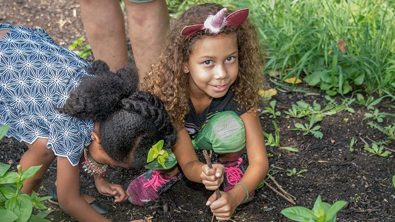 Young residents of West Woodlawn help out in a community garden