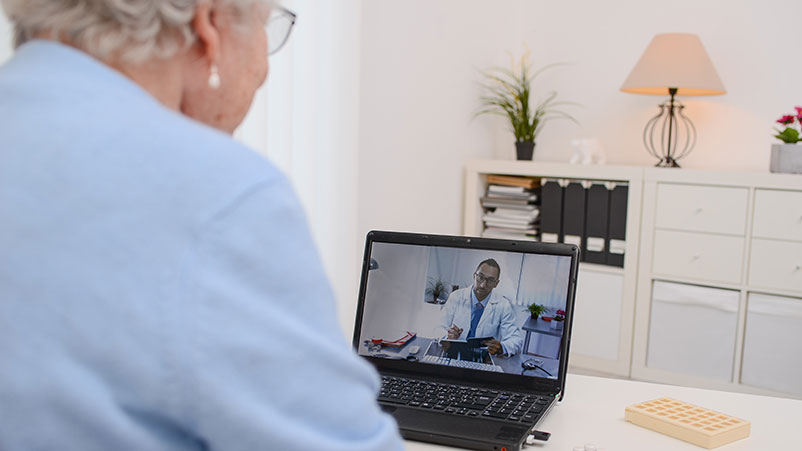 Older woman talking with her doctor on a computer screen