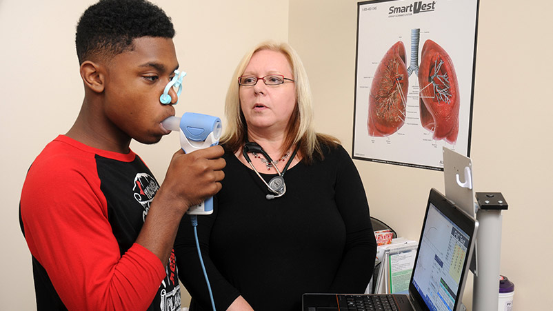 Louise Giles MD with patient